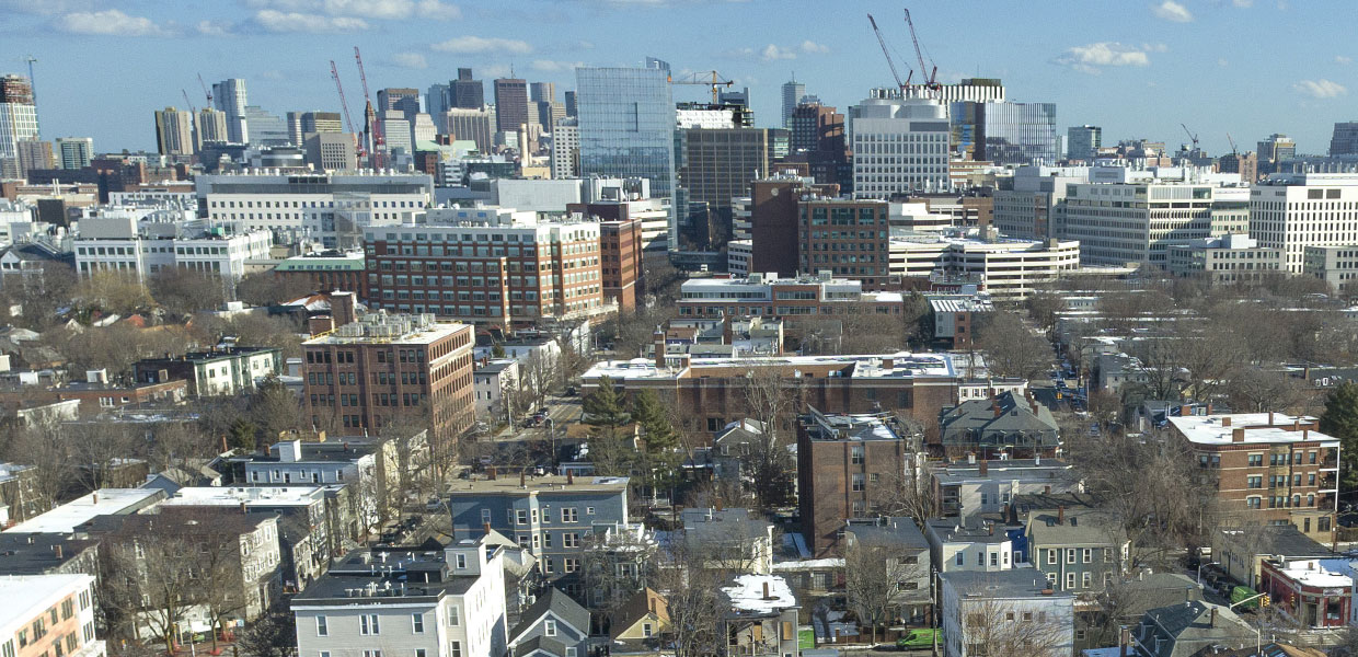 Kendall Square rises among the diverse neighborhoods it borders. Photo by Greig Cranna.