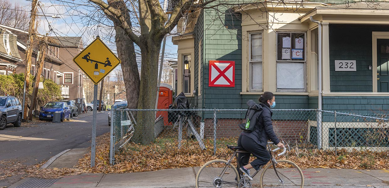 A red X appears on vacant buildings throughout Cambridge. Many are undergoing renovation like this one in the Coast neighborhood. Photo by Lou Jones.